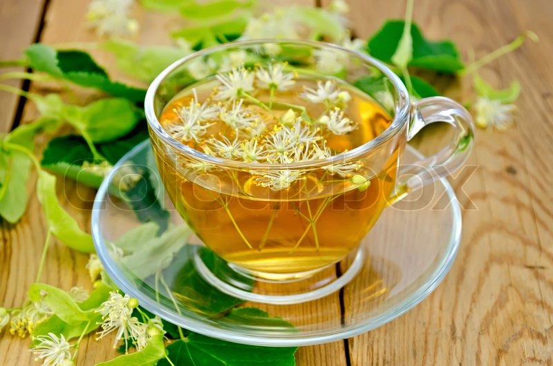 8186255-herbal-tea-from-linden-flowers-in-a-cup-on-the-board