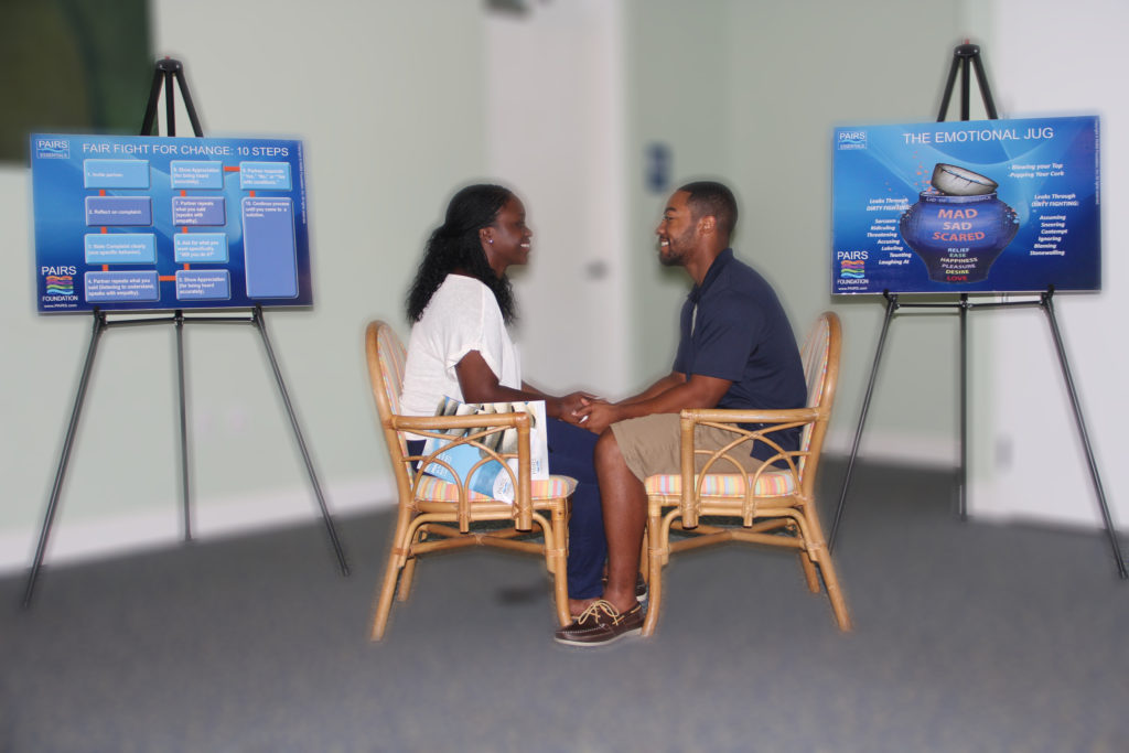 Couple learn communication and conflict resolution skills in supporting healthy marriage class.
