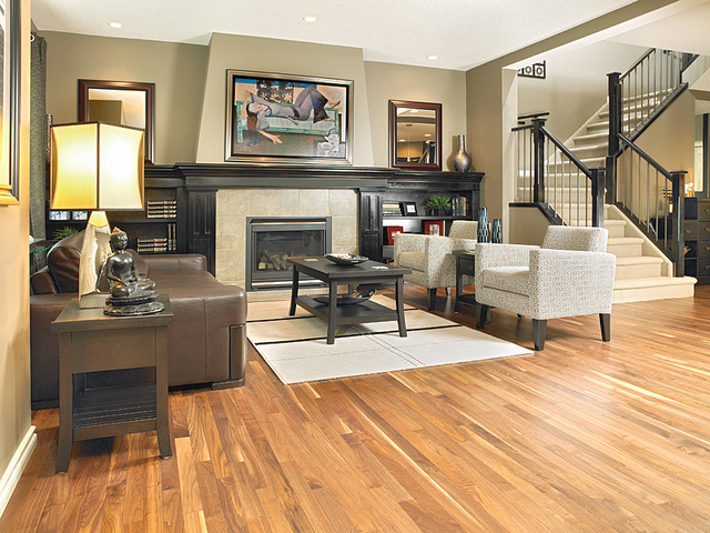 Living room with a natural American Walnut hardwood floor.