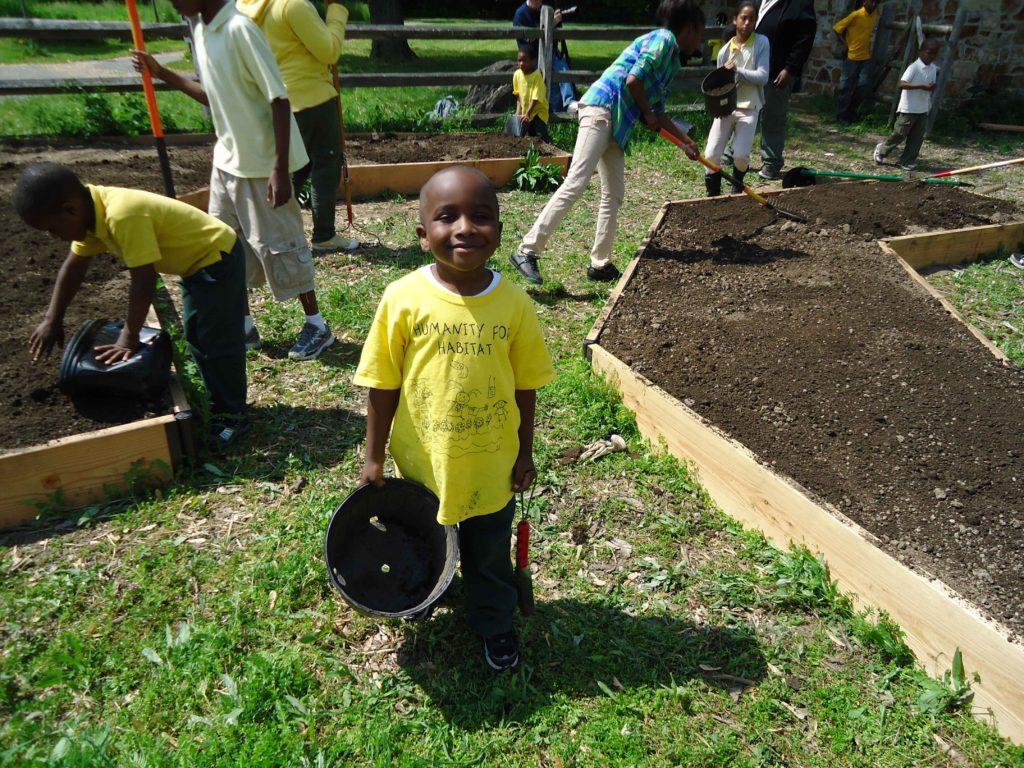 children_volunteers_helping_plant_a_pollinator_garden